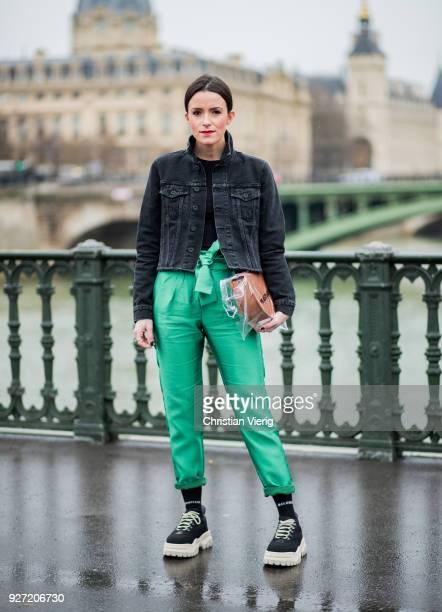 Lisa Pedigrew wearing dark denim jacket Off White green pants Maje Aeron bag plastic bag Off White sneakers Eytys is seen during Paris Fashion Week...