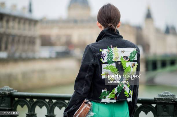 Lisa Pedigrew wearing dark denim jacket Off White green pants Maje Aeron bag plastic bag Off White sneakers Eytys is seen during Paris Fashion Week...