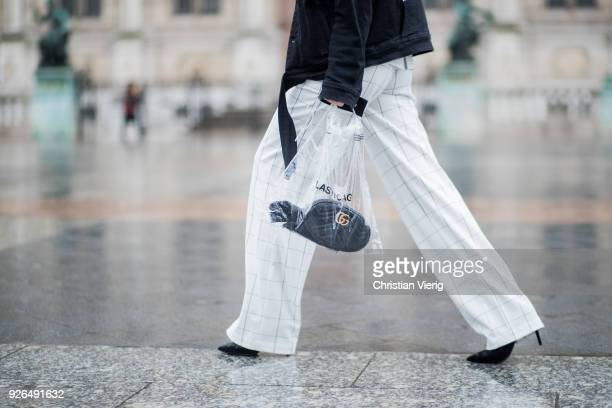 Lisa Pedigrew wearing Off White jacket Gucci cap top and pants Aeron Gucci bag off White see through transparent bag on March 2 2018 in Paris France