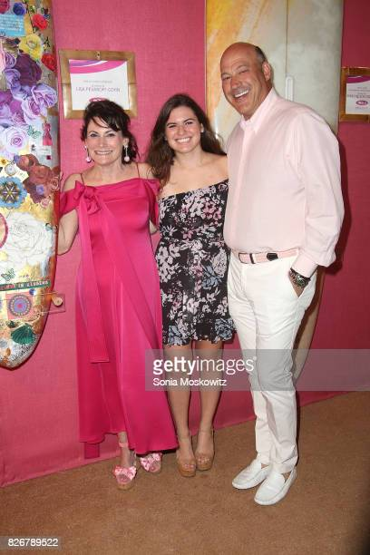 Lisa PevaroffCohn Chloe Cohn and Gary Cohn attend the Hamptons Paddle Party for Pink on August 5 2017 at Fairview on Mecox Bay Bridgehampton New York