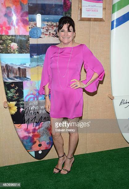 Lisa PevaroffCohn toasts to Paddle for Pink with Moet Ice Imperial on August 1 2015 in Bridgehampton New York