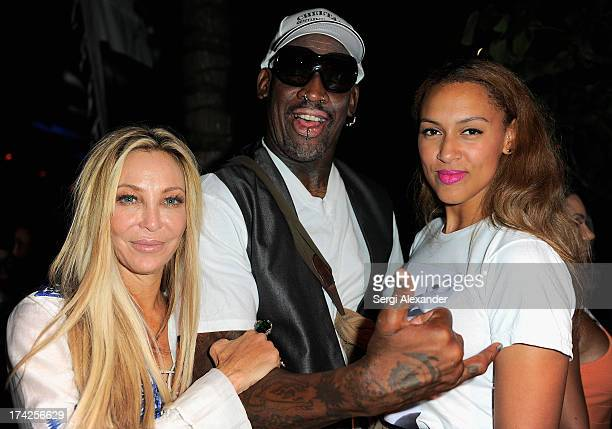 Lisa Pliner Dennis Rodman and Alexis Rodman attend the Minimale Animale show during MercedesBenz Fashion Week Swim 2014 at Oasis at the Raleigh on...