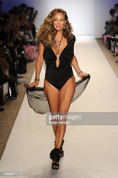 Lisa Pliner walks the runway at the Nicolita show during MerecedesBenz Fashion Week Swim 2012 on July 18 2011 in Miami Beach United States