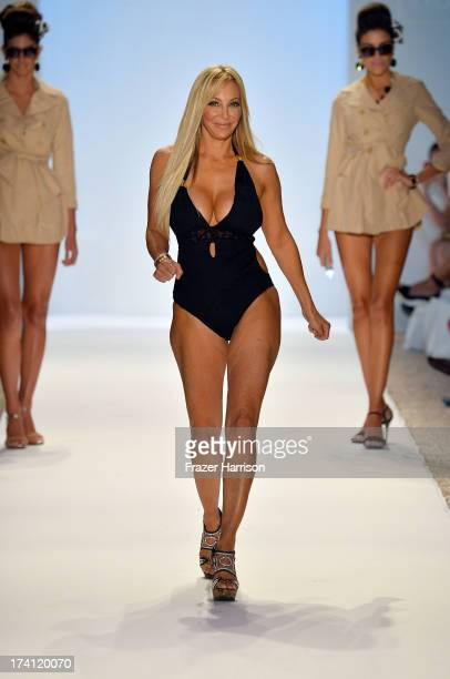Lisa Pliner walks the runway at the Nicolita show during MercedesBenz Fashion Week Swim 2014 at Oasis at the Raleigh on July 20 2013 in Miami Florida