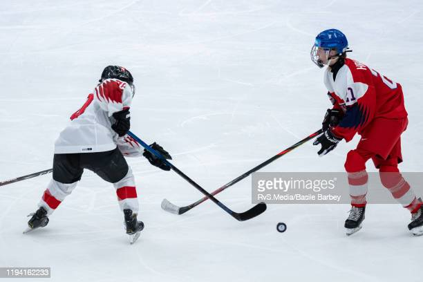 Lisa Poletti of Switzerland battles for the puck with Anezka Hracova of Czech Republic during Women's 6-Team Tournament Preliminary Round - Group B...