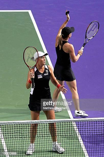Lisa Raymond and Liezel Huber of the United States celebrate their win over Katarina Srebotnik of Slovenia and Kveta Peschke of the Czech Republic...