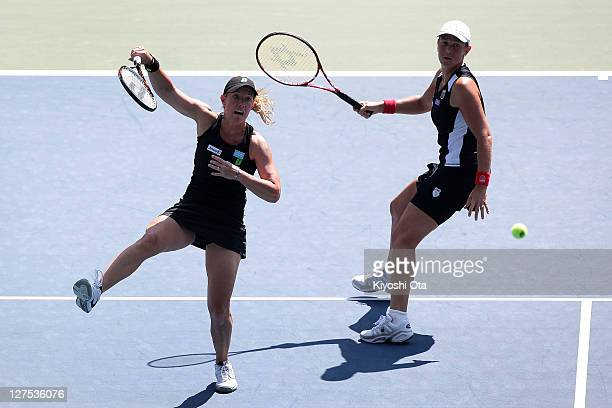 Lisa Raymond and Liezel Huber of the United States play in their doubles match against Chan YungJan of Chinese Taipei and Julia Goerges of Germany...
