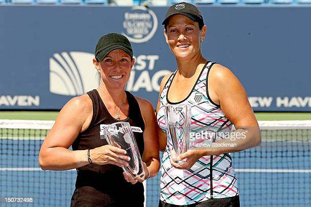 Lisa Raymond and Liezel Huber pose for photographers after defeating Adrea Hlavackova and Lucie Hradecka of the Czech republic during the doubles...