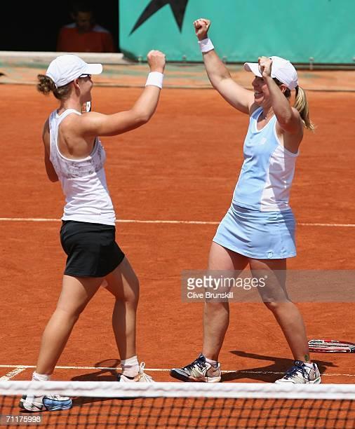 Lisa Raymond of the United States and Samantha Stosur of Australia celebrate victory against Daniela Hantuchova of Slovakia and Ai Sugiyama of Japan...