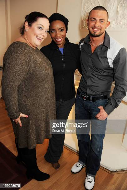Lisa Riley and Robin Windsor pose backstage with cast member Heather Headley at the West End production of 'The Bodyguard' at Adelphi Theatre on...
