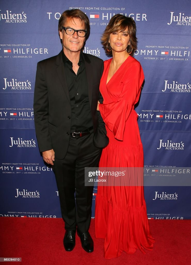 Lisa Rinna (R) and Harry Hamlin attend Julien's Auctions and Tommy Hilfiger VIP reception on October 19, 2017 in Los Angeles, California.