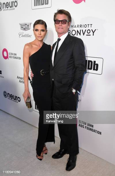 Lisa Rinna and Harry Hamlin attend the 27th annual Elton John AIDS Foundation Academy Awards Viewing Party Celebrating EJAF And The 91st Academy...