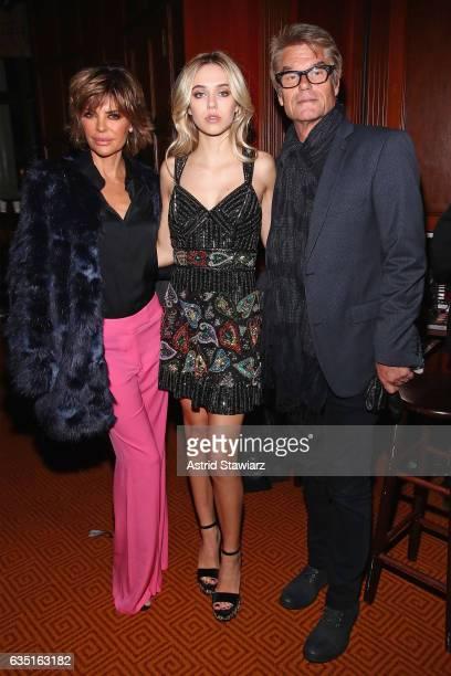 Lisa Rinna Delilah Belle Hamlin and Harry Hamlin pose backstage at the Sherri Hill NYFW Fall 2017 Runway Show during New York Fashion Week at Gotham...
