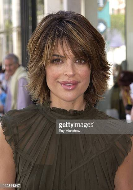 Lisa Rinna wearing Alberta Ferretti during Vogue Takes Beverly Hills Rodeo Drive Grand Finale at Rodeo Drive in Beverly Hills California United States