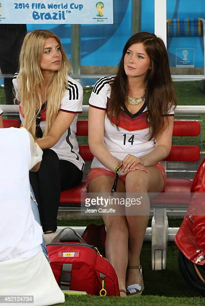 Lisa Rossenbach girlfriend of Roman Weidenfeller and Lena girlfriend of Julian Draxler look on after the 2014 FIFA World Cup Brazil Final match...