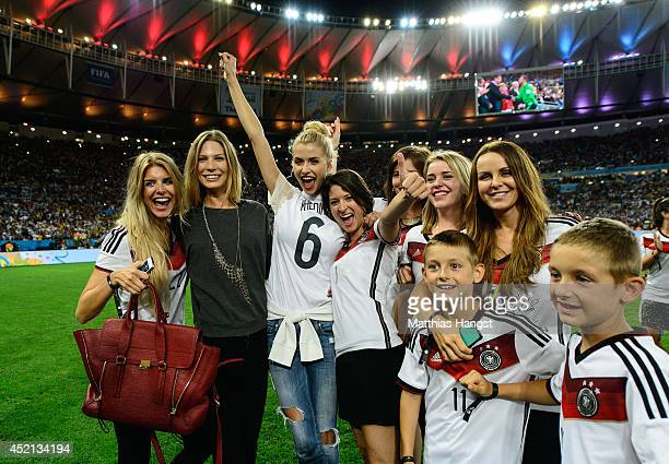 Lisa Rossenbach, Sarah Brandner, Lena Gercke, Kathrin Glich, Lisa Wesseler and Sylwia Klose celebrate after Germany defeat Argentina 1-0 in extra...