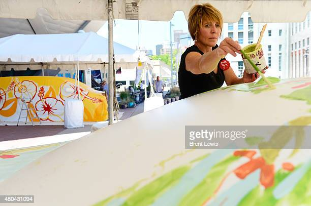 Lisa Russell fills in some areas on the roof of a Toyota Camry on Saturday July 11 2015 at the Denver Art Museum in Denver Colorado Colorado artists...