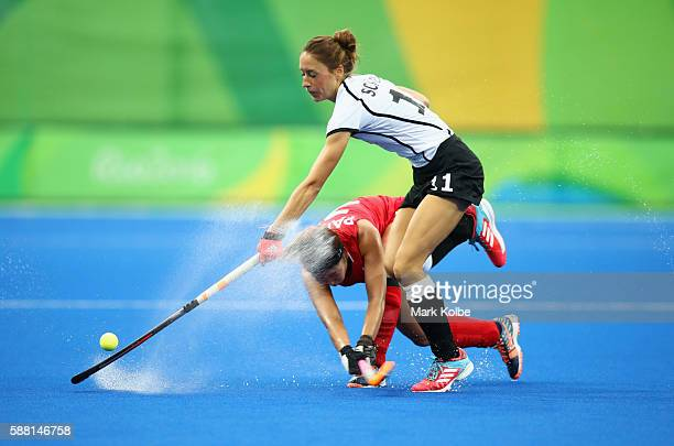 Lisa Schutze of Germany and Kiju Park of Korea battle for the ball during the Women's Pool B Match between Germany and Korea on Day 5 of the Rio 2016...