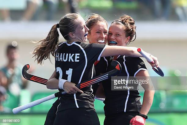 Lisa Schutze of Germany celebrates with teammates after scoring a goal against New Zealand during the Women's Bronze Medal Match on Day 14 of the Rio...