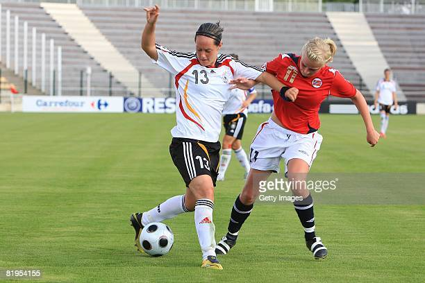 Lisa Schwab of Germany and June Tames of Norway fight for the ball during the Women's U19 European Championship match between Germany and Norway at...