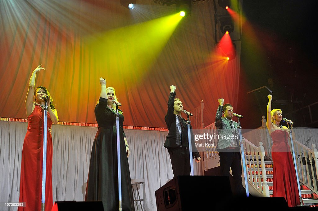 Lisa Scott-Lee, Claire Richards, Ian 'H' Watkins, Lee Latchford-Evans and Faye Tozer of Steps perform at London Palladium on December 2, 2012 in London, England.