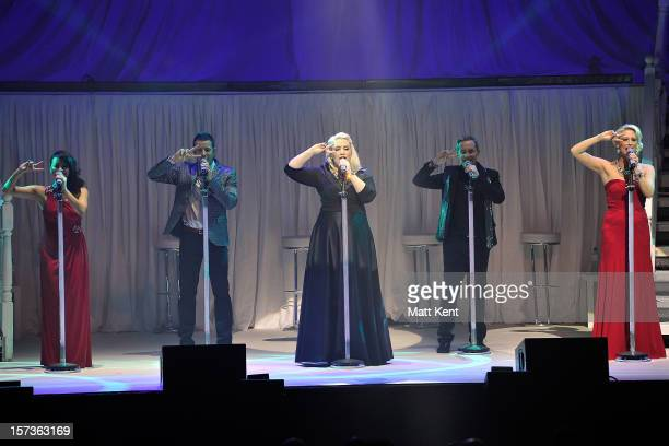 Lisa ScottLee Lee LatchfordEvans Claire Richards Ian 'H' Watkins and Faye Tozer of Steps perform at London Palladium on December 2 2012 in London...