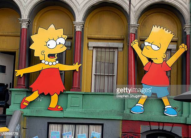 Lisa Simpson and Bart Simpson cutouts on display at The Simpsons 350th episode block party on the New York street of Fox Pico Lot on April 25 2005 in...