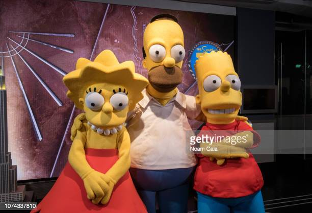 Lisa Simpson Homer Simpson and Bart Simpson visit The Empire State Building to celebrate the 30th anniversary of The Simpsons at The Empire State...
