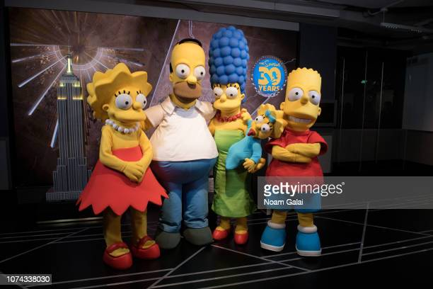 Lisa Simpson Homer Simpson Marge Simpson Maggie Simpson and Bart Simpson visit The Empire State Building to celebrate the 30th anniversary of The...
