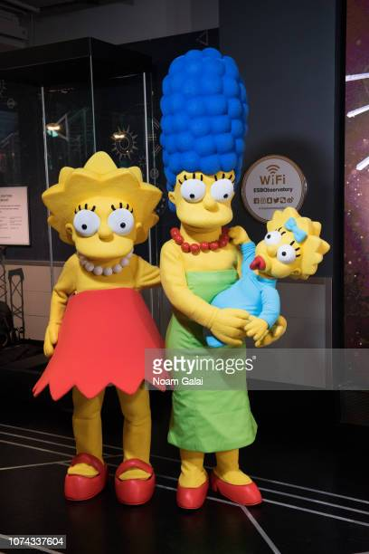 Lisa Simpson Marge Simpson and Maggie Simpson visit The Empire State Building to celebrate the 30th anniversary of The Simpsons at The Empire State...