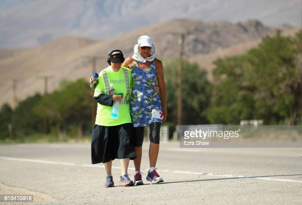 Lisa SmithBatchen walks with Sister Mary Beth Lloyd a member of her support team during the STYR Labs Badwater 135 on July 12 2017 in Death Valley...