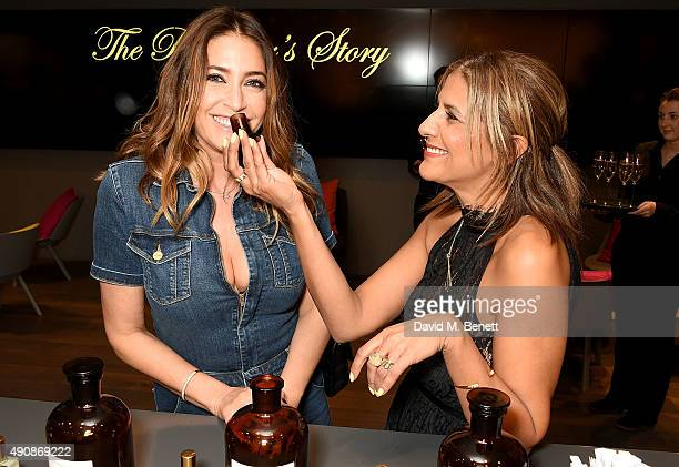 Lisa Snowdon and Azzi Glasser attend the Azzi Glasser Fragrance Launch at Harvey Nichols on October 1 2015 in London United Kingdom