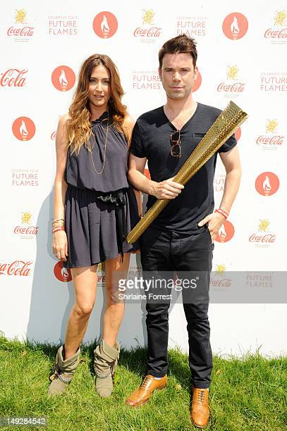 Lisa Snowdon and Dave Berry pose backstage at the London 2012 Olympic Torch Relay Finale Concert in London's Hyde Park presented by CocaCola on July...