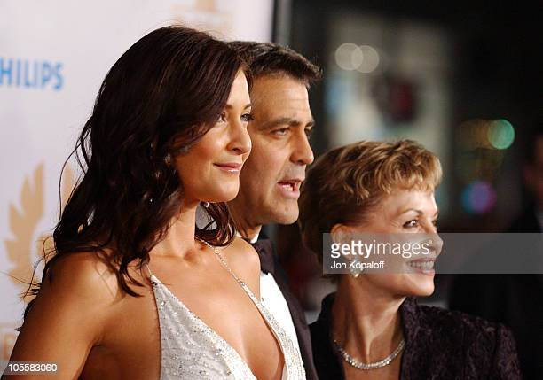 Lisa Snowdon and George Clooney during Ocean's Twelve Los Angeles Premiere Arrivals at Grauman's Chineese Theater in Los Angeles California United...