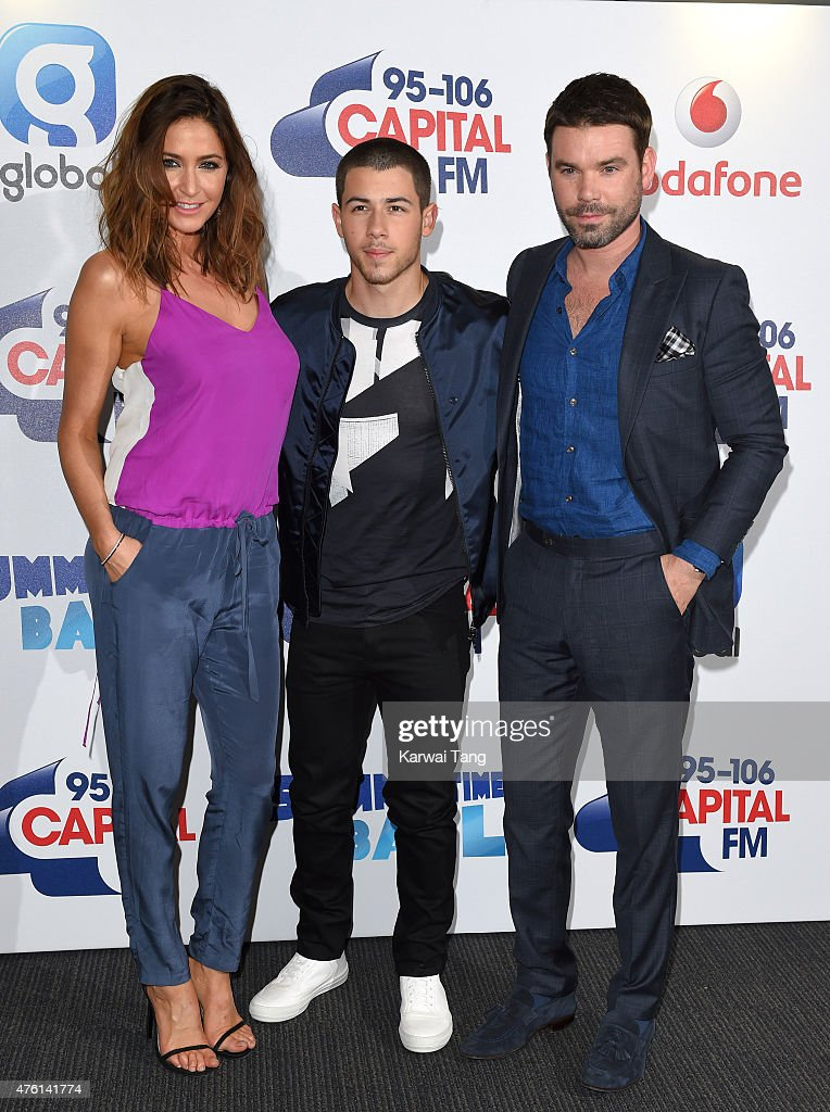 Lisa Snowdon, Nick Jonas and Dave Berry attend the Capital FM Summertime Ball at Wembley Stadium on June 6, 2015 in London, England.