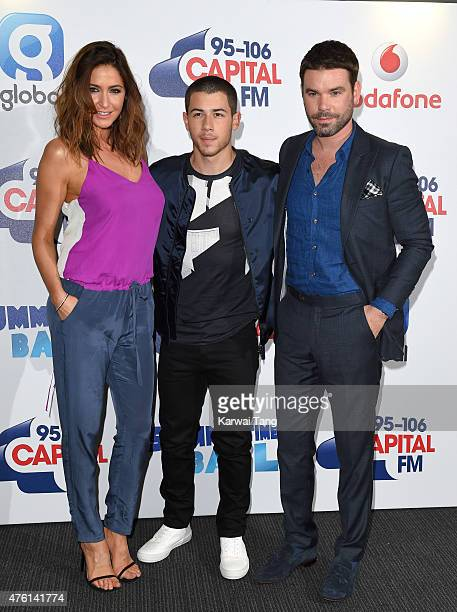 Lisa Snowdon Nick Jonas and Dave Berry attend the Capital FM Summertime Ball at Wembley Stadium on June 6 2015 in London England