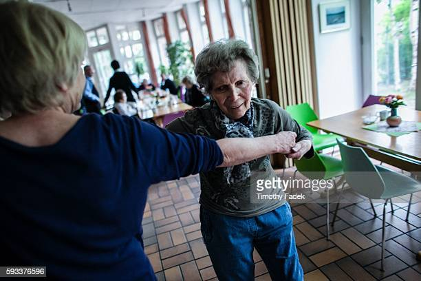 Lisa Steinbrink dances with a caregiver Elderly germans who have Alzheimer's disease dance to waltz foxtrot and other ballroom music at a community...