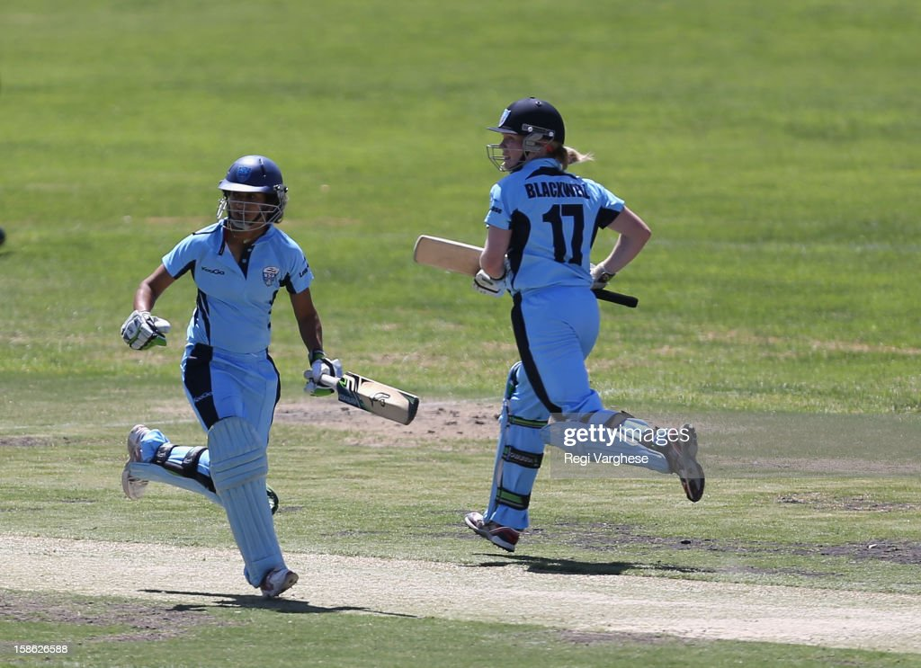 Lisa Sthalekar and Alex Blackwell of Breaker run between the wicket during the WNCL match between the South Australia Scorpions and the New South Wales Breakers at Prospect Oval on December 22, 2012 in Adelaide, Australia.