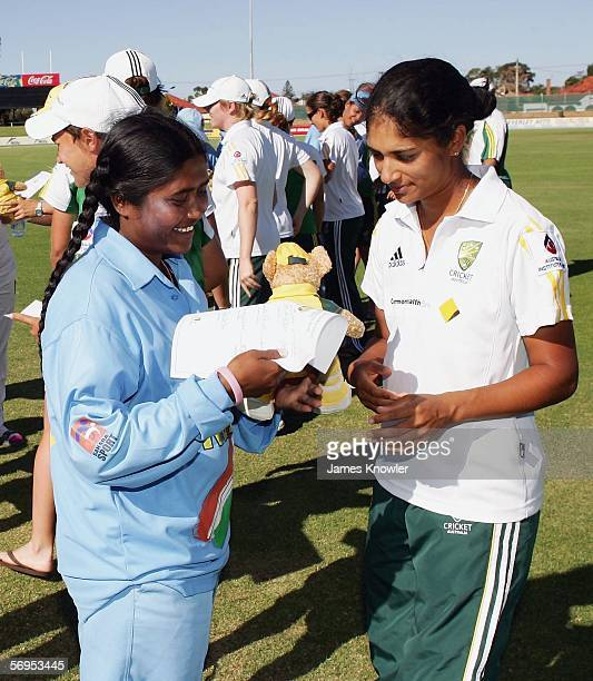 Lisa Sthalekar of Australia presents Neetu David of India with a Kangaroo toy after the third Women's International One Day match between Australia...