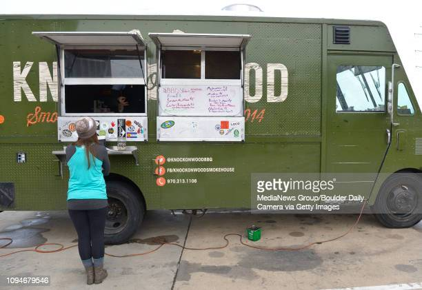Lisa Strachan orders food at the Knock On Wood food truck Friday at Wibby Brewing 209 Emery St