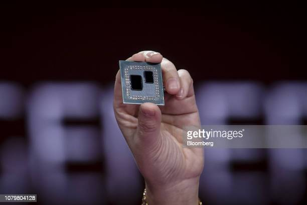 Lisa Su president and chief executive officer of Advanced Micro Devices holds a 3rd generation Ryzen desktop processor while speaking during a...
