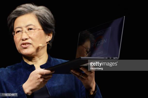 Lisa Su, president and chief executive officer of Advanced Micro Devices Inc. , presents the Lenovo Group Ltd. Yoga Slim 7 laptop computer during an...