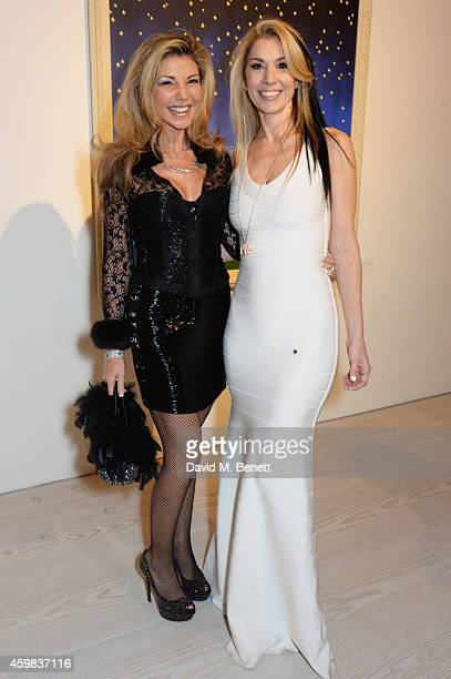 """Lisa Tchenguiz and Stasha Palos attend a private view of """"And The Stars Shine Down"""" by Stasha Palos at the Saatchi Gallery on December 2, 2014 in..."""