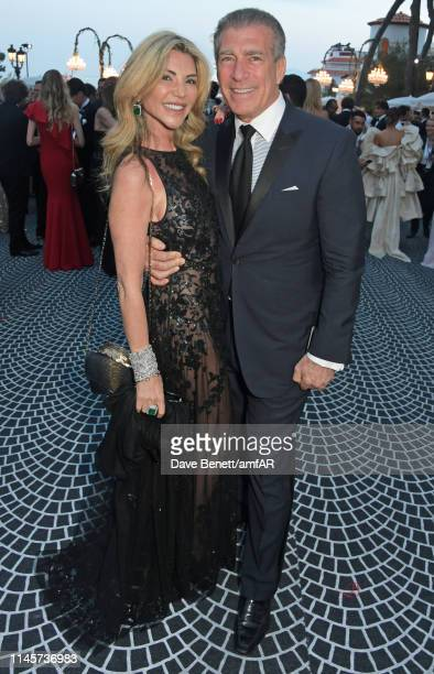 Lisa Tchenguiz and Steve Varsano attend the amfAR Cannes Gala 2019 at Hotel du CapEdenRoc on May 23 2019 in Cap d'Antibes France