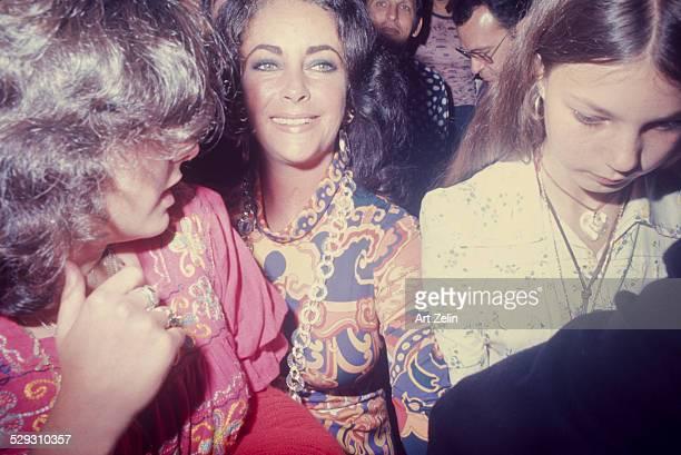 Lisa Todd Burton Elizabeth Taylor and Maria Bruton at a formal event circa 1970 New York