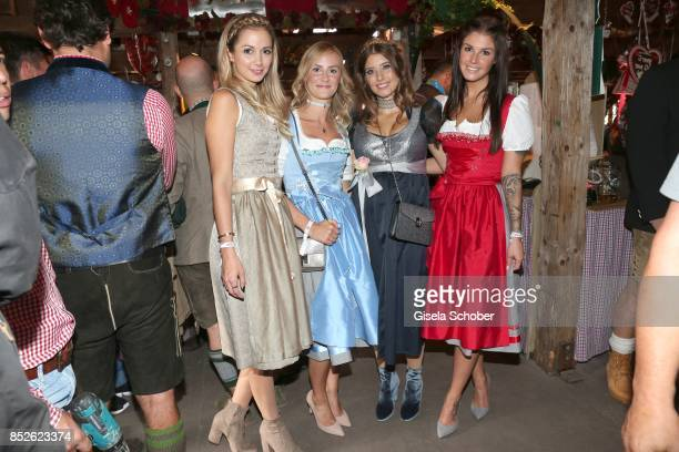 Lisa Ulreich, wife of Sven Ulreich, Elena Rudy, wife of FC Bayern soccer player Sebastian Rudy, Cathy Hummels wearing a dirndl by Angermaier Trachten...