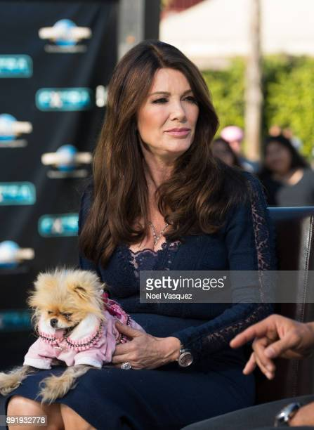 Lisa Vanderpump and her dog Giggy visit 'Extra' at Universal Studios Hollywood on December 13 2017 in Universal City California