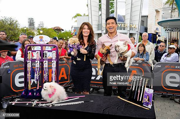 Lisa Vanderpump and Mario Lopez visit 'Extra' at Universal Studios Hollywood on May 5 2015 in Universal City California