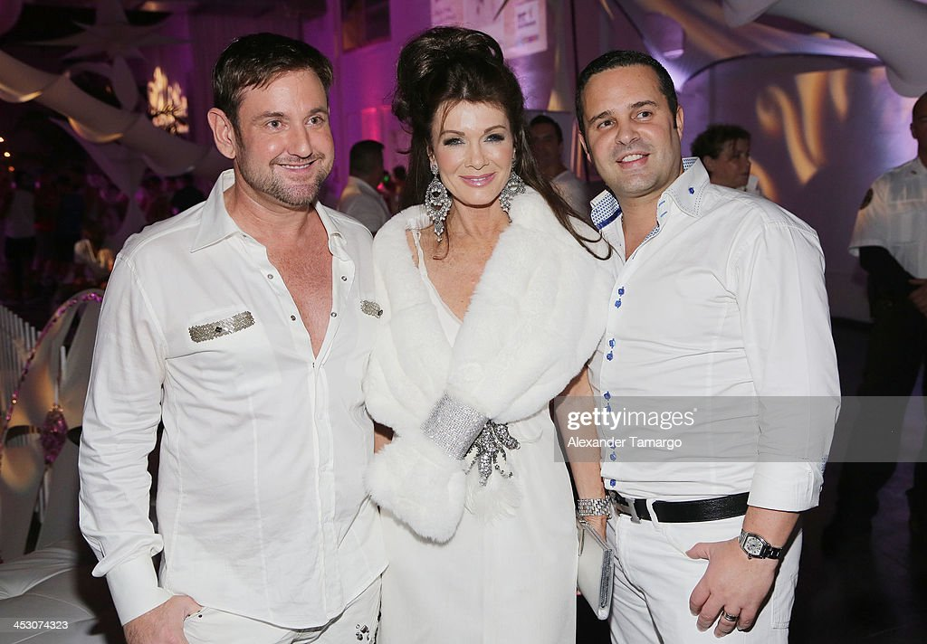 Lisa Vanderpump poses with guests while debuting LVP sangria at The White Party in Miami and help raise awareness for HIV/AIDS at Soho Studios on November 30, 2013 in Miami, Florida.