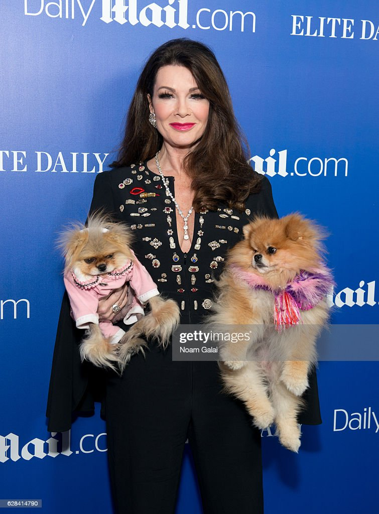 Lisa Vanderpump, with Giggy and Daddy, attends the DailyMail.com and Elite Daily holiday party at Vandal on December 7, 2016 in New York City.